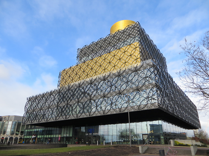 Image of the real life Library by By Alex Liivet from Chester, United Kingdom - Library of Birmingham, CC0, https://commons.wikimedia.org/w/index.php?curid=63979753